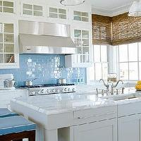 Suzanne Kasler - kitchens - blue subway tiles, blue subway tile backsplash, blue kitchen backsplash, white and blue kitchen, cottage kitchen, modern cottage kitchen, blue seat cushions, blue accents, blue kitchen accents, island prep sink, bamboo roller shades,