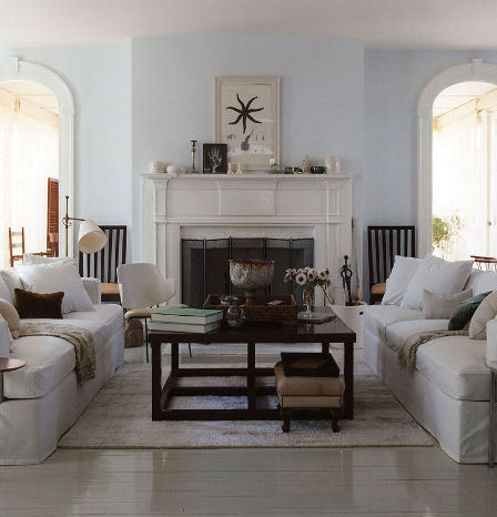 living rooms - fireplace wood coffee table white sofas blue walls beachy coastal  Thanks to Decor 8 flickr.    White sofas, espresso square coffee