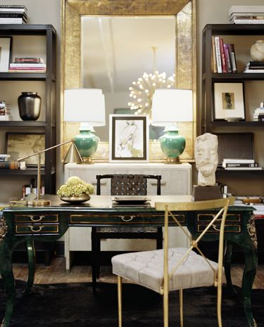 dens/libraries/offices - green antique desk gold leaf x-back chair jade green ceramic lamps mirror shelves white chest gold leaf beveled mirror black rug office