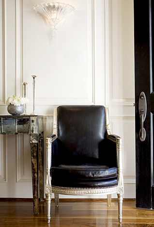 entrances/foyers - black leather chair mirrored console ivory cream black nail head trim  Windsor Smith Home!  Love this black leather chair