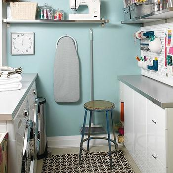 House & Home - laundry/mud rooms - craft room in laundry room craft room, laundry room, craft room and laundry room, blue walls, peg board, craft room peg board, gray ironing board, laundry room shelf, stainless steel floating shelf, floating stainless steel shelf,