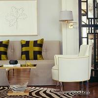 Jan Showers - living rooms - armless sofa, gray sofa, gray tufted sofa, armless gray sofa, green and black pillows, zebra cowhide rug, mirrored accent table, chair with lucite legs, Zebra Cowhide Rug,