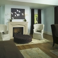 Ecomanor - bedrooms - white, wingback, chairs, fireplace, bird, wall, art, chocolate, brown, velvet, drapes, brown, wingback, chair, brown, tufted, ottoman, blue, walls, paint, color,