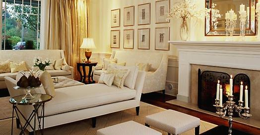 living rooms - fireplace beveled mirror gold silk drapes white curvy sofas white tufted ottoman stools white settee mirrored directoire table
