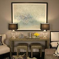 Daniel M Pafford - living rooms - faux, snake skin, console, table, stools, crystal, lamps, black, silk, shades, blue, wall art, painting, ivory, cream, tufted, chair, black, white, Greek key, pillows, cowhide, zebra, rug, gray, walls, entrance, foyer, Palm Beach Pillow,