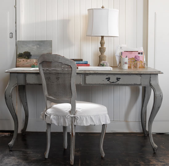 dens/libraries/offices - gray French desk gray painted cane chair white ruffled cushion wood lamp beadboard bedroom  Gray painted desk and chair!
