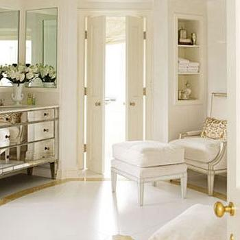 House Beautiful - bathrooms - mirrored bathroom vanity, mirrored vanity, bi fold doors, bathroom bi fold doors, mirrored washstand, round bathroom, round master bathroom, circular bathroom, circular master bathroom, bathroom chair, bergere chair,