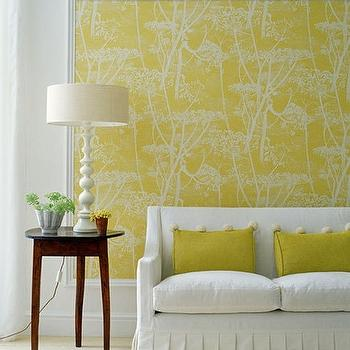 Cole & Son - living rooms - yellow wallpaper, bright yellow wallpaper, yellow cow parsley wallpaper, skirted sofa, white sofa with yellow pillows, yellow pillows, white and yellow living room, Cow Parsley Wallpaper,