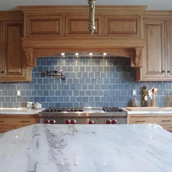 Teresa Meyer Interiors - kitchens - blue subway tile backsplash, blue subway tile, blue subway tile kitchen, blue subway tile backsplash, blue subway tile kitchen, recycled glass tiles, blue recycled glass tiles, maple cabinets, maple kitchen cabinets, white marble countertops, Artistic Blue Glass Tiles, Pot Filler, Marble,