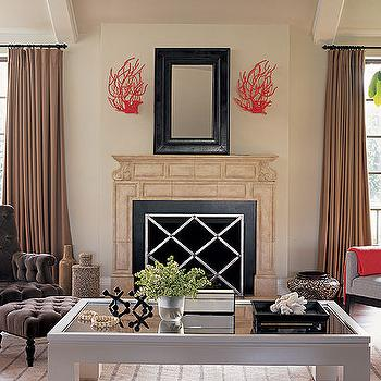 Burnham Design - living rooms - red accents, coral sconces, wall detailing, vaulted ceiling, red coral, coral, coral decor, coral wall decor, red coral decor, red coral wall decor, red coral sconces, coral sconces, brown velvet bench,
