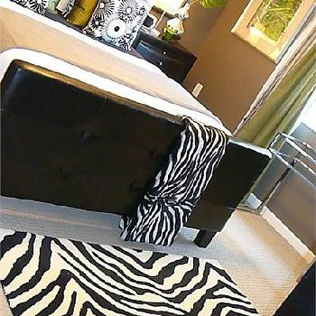 HGTV - bedrooms - zebra rug, leather bed, leather tufted bed, zebra throw, zebra throw blanket,  Black green brown bedroom design with leather