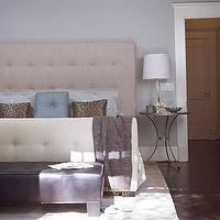 Elle Decor - bedrooms - pale blue walls, tufted headboard, bench,  Classic, neutral bedroom - ivory tufted bed and blue silk pillows