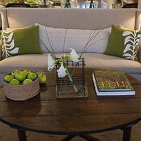 HGTV - living rooms - reclaimed wood coffee table, oval coffee table, slipcovered sofa, linen sofa, green pillows, wingback sofa, slipcovered wingback sofa,