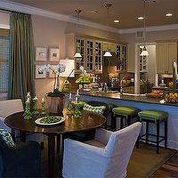 HGTV - dining rooms - round, dining table, slip-covered, chairs, green, stool, cushions, green, silk, drapes, sisal, rug, beige walls, dining room,