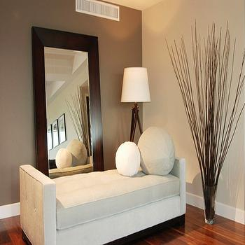 Nicole Sassaman - entrances/foyers - taupe paint, taupe paint colors, taupe paint color, taupe walls, velvet settee, velvet bench, floor mirror, tripod floor lamp, accent wall, taupe accent wall,