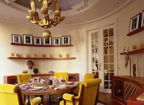 dining rooms - yellow, tufted, scroll, upholstered, dining chairs, walnut, round dining table, mid-century, modern, curved, buffet, French, doors, gold, chandelier, picture ledges, yellow walls, dining room,