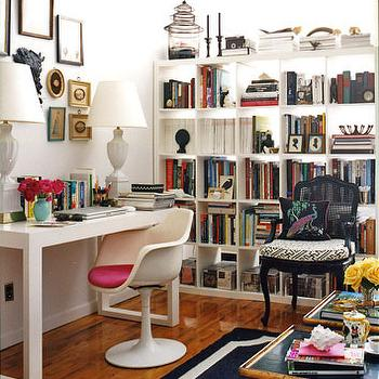 Domino Magazine - dens/libraries/offices - ikea expedit, expedit bookcase, ikea expedit bookcase, white ikea bookcase, white ikea expedit bookcase, bookcase room partition, , Saarinen Tulip Chair,