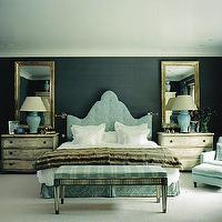 Nicholas Haslam - bedrooms - blue, velvet, tufted, headboard, blue, white, striped, bench, blue, damask bed skirt, antique, gray, nightstands, gold leaf, beveled, mirrors, turquoise, blue, ceramic, lamps, velvet, blue, accent, chair, ottoman, black wallpaper, walls,