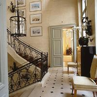 Alberto Pinto - entrances/foyers - iron staircase, chandelier, wall art, chairs, chest,  Ornate staircase - Love the ornate staircase and blue