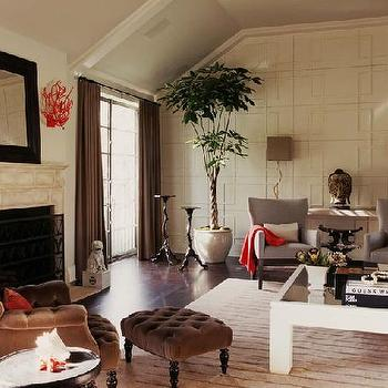 Burnham Design - living rooms - red accents, coral sconces, wall detailing, vaulted ceiling, red coral, coral, coral decor, coral wall decor, red coral decor, red coral wall decor, red coral sconces, coral sconces, brown velvet bench, full wall wainscoting, brown velvet chair,