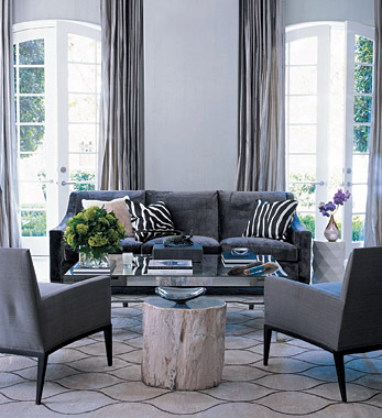 Charcoal gray couch transitional living room elle decor for Grey couch living room