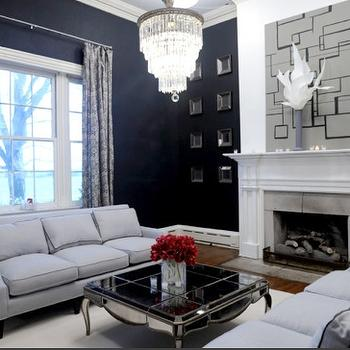 HGTV - living rooms - mirrored coffee table, mirror coffee table, mirrored cocktail table, light blue sofa, 3 cushion sofa, navy blue walls, navy walls, beveled mirrors, face to face sofas, living room chandeliers, Mirrored Coffee Table,