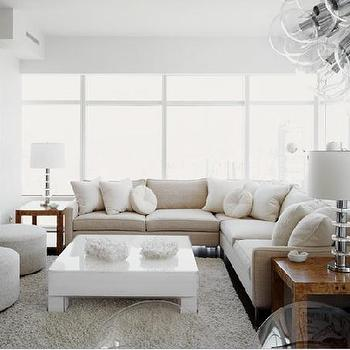 living rooms - lacquered coffee table, white lacquered coffee table, chunky coffee table, white coffee table, sectional, sectional sofa, beige sectional, beige sectional sofa, cube end tables, gray flokati rug, gray sheepskin rug,
