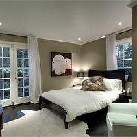 HGTV - bedrooms - taupe paint, taupe paint colors, taupe paint color, taupe walls, black bed, black platform bed, white cowhide rug, white curtains, white drapes, french doors, bedroom french doors, White Cowhide Rug,