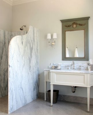 Kathryn: Shower wall  marble shower walls, ivory bathroom vanity, mirror and sconces.