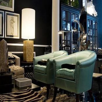 living rooms - teal chairs, leather chairs, teal leather chairs, zebra rug, black walls, chair rail,  dramatic  Teal leather club chairs, zebra
