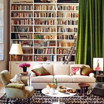 Domino Magazine - dens/libraries/offices - built-ins, built-in cabinets, library built-ins, library built in cabinets, white built-ins, white built-in cabinets, built-in bookcases, library bookcase, floor to ceiling built-ins, floor to ceiling built-in cabinets, built in bookshelves, bookshelves, white bookshelves, white bookcases, white built-in bookcases, white built in bookshelves, green curtains, green silk curtains, green drapes, green silk drapes, saarinen coffee table,