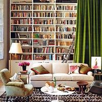 Domino Magazine - dens/libraries/offices - built-in, bookshelves, sofa, saarinen, marble, coffee, table, green, silk, drapes, brass, built-ins, built-in cabinets, library built-ins, library built in cabinets, white built-ins, white built-in cabinets, built-in bookcases, library bookcase, floor to ceiling built-ins, floor to ceiling built-in cabinets, built in bookshelves, bookshelves, white bookshelves, white bookcases, white built-in bookcases, white built in bookshelves,