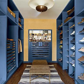 Nate Berkus Design - closets - blue cabinets, closet cabinets, closet built ins, closet built in cabinets, blue built ins, blue built in cabinets, blue and yellow closet, shoe shelves, mens closet,