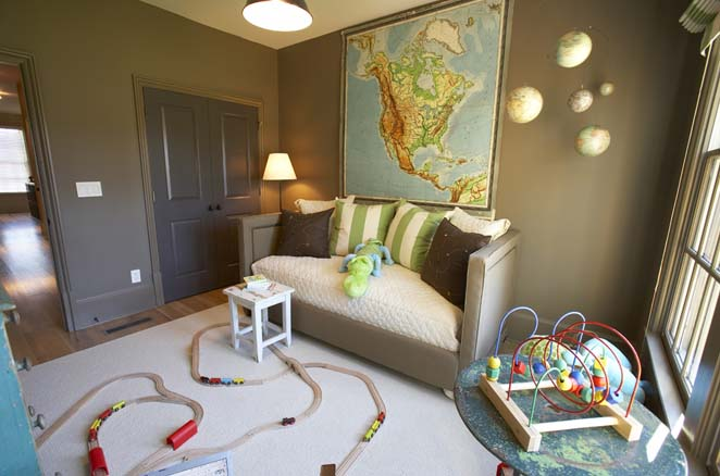 Fun, playful boy's room! Map art on dark taupe gray walls and sleeper sofa