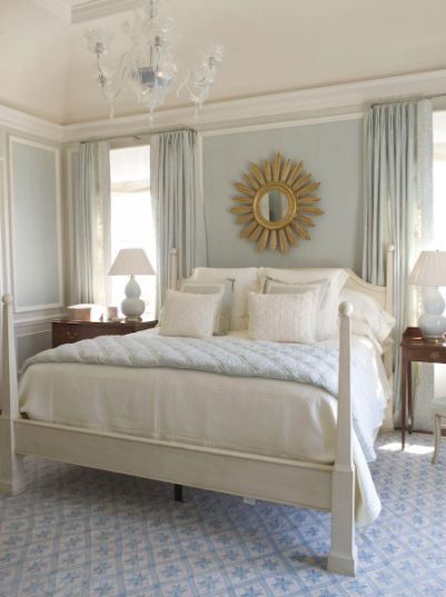 Phoebe Howard - bedrooms - Benjamin Moore - Glass Slipper - light blue walls, light blue paint colors, light blue curtains, light blue drapes, trim molding, gold sunburst mirror, poster bed, white poster bed, mismatched nightstands, light blue lamps, light blue gourd lamps,