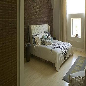 bedrooms - tufted wingback headboard, white tufted wingback headboard, tufted headboard, white tufted headboard, wingback headboard, white wingback headboard, exposed brick wall, bedroom exposed brick wall,