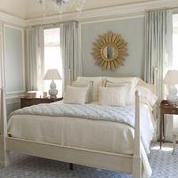 Phoebe Howard - bedrooms - light blue walls, light blue paint colors, light blue curtains, light blue drapes, trim molding, gold sunburst mirror, poster bed, white poster bed, mismatched nightstands, light blue lamps, light blue gourd lamps,