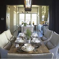 Westbrook Interiors - dining rooms - oatmeal, linen, slip-covered, dining chairs, rustic, farmhouse, dining table, oatmeal, linen, drapes, black, lantern, pendant, lighting, black walls, cottage, dining room,