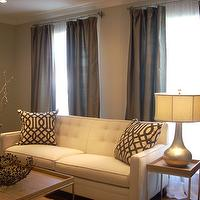 living rooms - suzie, Pottery Barn, taupe, dupioni silk, drapes, West Elm coffee table, zebra wood, brown, gray, beige, green, gold, celadon, living room, celadon, floor vase, grant beige, greige paint, greige walls, greige paint colors, greige paint color, gray beige paint, gray beige walls, Taupe Dupioni Silk Drapes, Arhaus Sofa, Z gallerie Trellis Pillow, Horchow Gold Leaf Gourd Lamp,