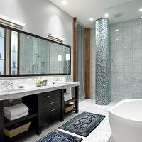 bathrooms - Mirror, bathtub, area, rug, shower, gray tile, towel, column,  Luxurious bathroom
