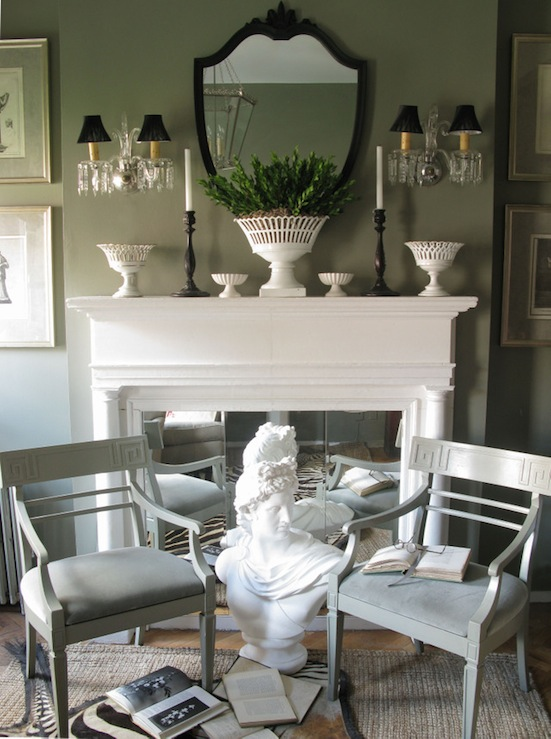 living rooms - gray painted French chairs white bust white fireplace milk glass vases black candlesticks brass sconces black silk shades black Victorian mirror vertical botanical art gallery sisal rug living room