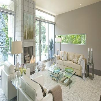 Benjamin Moore - living rooms: gray walls, gray paint colors,  White leather sofa and chairs, fireplace, flokati rug, acrylic lucite tables,