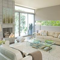 Benjamin Moore - living rooms - Benjamin Moore - Willow Creek - flokati, rug, acrylic, lucite, tables, leather, chairs, sofa, glass column, lamp, fireplace, gray walls,
