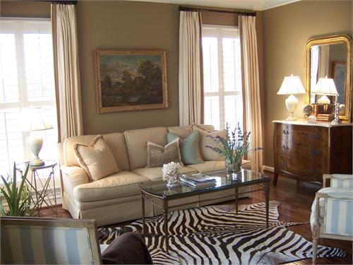 living rooms - Zebra Cowhide Rug coffee table sofa striped blue white bergere chairs walnut chest lamp mirror ivory drapes taupe  Beautiful Living