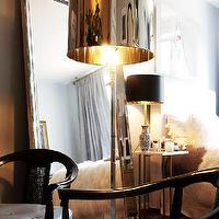bedrooms - polished chrome lamp, beveled mirror,  the selby  polished chrome lamps, beveled mirror and asian black chairs.