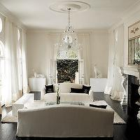 Jill VanTosh - living rooms - espresso, dark, wood, floors, white sofa, white chairs, black, velvet, throw pillows, stone, fireplace, crystal, chandelier, white, rug, white, silk, curtains,