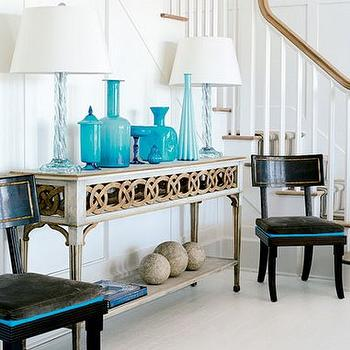Suzanne Kasler - entrances/foyers - turquoise bottles, turquoise blue bottles, gray console table, black accent chairs,  Beachy coastal turquoise