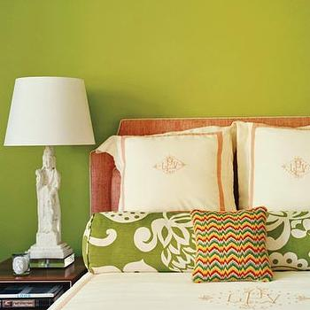 Domino Magazine - bedrooms - asian lamp, bolster pillow, green bolster pillow, white and green bolster pillow, monogrammed bedding, monogrammed shams, monogrammed duvet, chinese figurine lamp, chinoiserie lamp, pink headboard, pink and green bedroom,