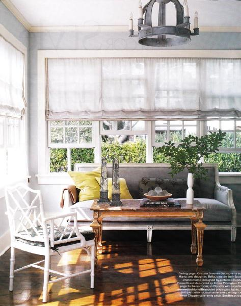 Suzie:  Emma Pilkington!   Pretty gray sunroom!  Love the frilly white linen silk roman shades ...
