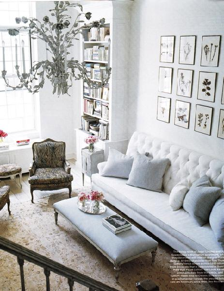 living rooms - white faux bamboo chandelier white tufted sofa botanical gallery wall art photo gallery gray bergere chair gray blue linen bench living room